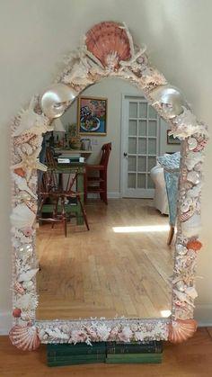 Custom shape Seashell mirror. elegantshells.net Heather kendall Designs Tampa Florida | Sea shell decor, Seashell mirror, Seashell chandelier Seashell Chandelier, Tampa Florida, Shell Art, Fireplace Surrounds, Beach Themes, Coastal Living, Sea Shells, Kendall, Mirrors