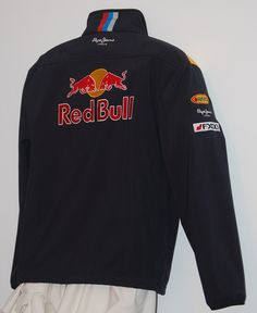 Red Bull Racing Team F1 Jacket / 2011 Collectible - free shipping - - MAKE AN OFFER - PRODUCT DESCRIPTION: Original Item condition: Pre-owned In excellent condition. Country/Region of Manufacture: China For Men Size L. Team Red Bull Racing Formula 1. Model of the year: 2011. Material:100% polyester. High quality fabric and colors.