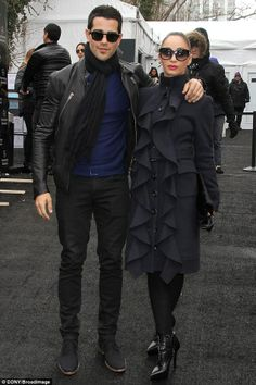 Oh that coat! Cara Santana and beau Jesse Metcalfe.