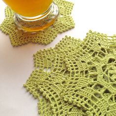 Coasters By Artistic NeedleWork These small 5 inch doilies are made from a 1916 pattern. Done in a soft lime green, these coasters are made with a high quality #10 - 3 ply 100% Bamboo thread. Bamboo is a natural fiber and typically creates a soft, lightweight piece with a drape to it, so these doilies are blocked with a medium starch. Small rounds and squares can also be used as appliques on clothing or pillows. Photo props not for resale. See more doilies here: http://www.etsy.co...
