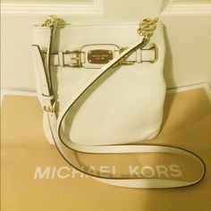 Michael Kors crossbody RARE! Authentic MK crossbody NWOT purchased a few months ago and never used it, fantastic bag and fantastic quality, has gold chains and a gold buckle on the strap, very durable, open to reasonable offers no trades please Michael Kors Bags Crossbody Bags