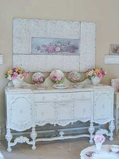 Beautiful sideboard painted white.