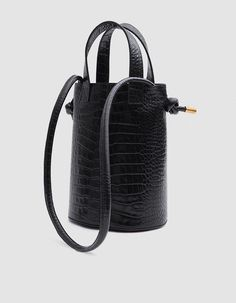Bucket bag from TRADEMARK in Black. Crocodile-embossed leather. Two top handles. Shoulder strap. Open top. Interior zip pocket. Unlined. Structured base.   • Leather • Made in Italy