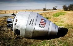 An abandoned cement truck turned into a crashed NASA rocket by street artists.