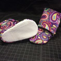 These purple paisley booties are the perfect finish to an adorable outfit!