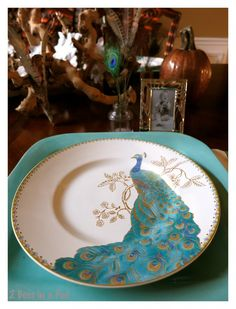 I love this turquoise peacock pattern china. It perfectly matched my large square plates. A great combination and colorful Fall tablescape...