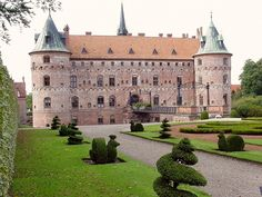 Denmark's Egeskov Castle, with its ditch and drawbridge, is present treasure of times of the Renaissance
