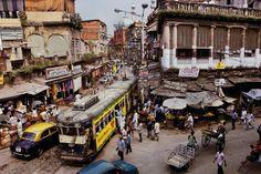 Steve McCurry.   INDIA. Calcutta. 1996. A tram winds its way through the streets of Calcutta.