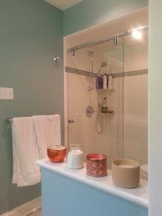 Shared Girl's Bathroom renovation including new tile and shower, and vanity with Corian countertop.  Angled mirror conceals pipe chase to second floor Master Bathroom.