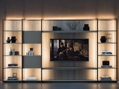 Build simple tv stand continuum bookcase with by design b storage wall Tv Cabinet Design, Tv Wall Design, Tv Unit Design, House Design, Hotel Romantique Paris, Simple Tv Stand, Bookcase Lighting, Tv Wanddekor, Bibliotheque Design