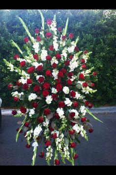 Standing spray white and red.Desde la distancia querida amiga enviandote nuestras condolencias ati y angie.QDLBM.Agel R.I.P.