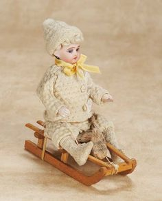 De Kleine Wereld Museum of Lier: 143 German Bisque Child on Sled as Candy Container
