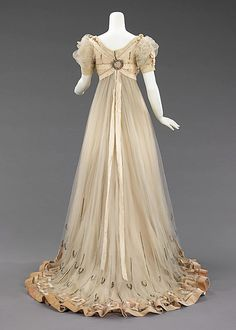 Evening dress Design House: House of Paquin  Designer: Mme. Jeanne Paquin Date: 1905–7 Culture: French Medium: silk, silver, rhinestones Accession Number: 2009.300.1112