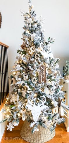 Are you planning to decorate for Christmas with a white flocked Christmas tree this year? On the blog, I'm sharing how I decorated our white flocked Christmas tree with neutral wood accents.