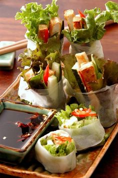 Vietnamese Spring Rolls – tofu, basil, garlic soy dip. I would make them with regular tofu rather than fried. You can also add any veggies you want. Mmm...