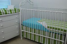 Green stripe blanket, crib skirt and changing pad with a sky-blue sheet