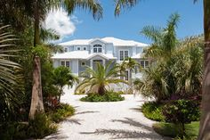 """Lush landscaping welcomes you to this Sanibel Island vacation home named """"A Beach Path"""""""