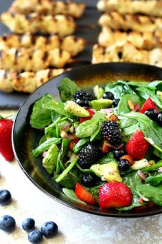 Get ready to shake up your summer cookout with this sweet, colorful and oh-so-sassy easy-to-make bright Triple Berry Almond Spinach Salad!
