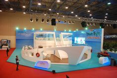 Think how the shape of your brand's core offering may be incorporated into a unique, exciting stand design. Emirates Heights by Ahmed Ali, via Behance Temporary Architecture, Architecture Design, Stand Design, Booth Design, Expo Stand, Exhibition Stall, Wall Of Fame, Trade Show, Event Design