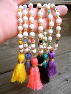Beaded Stretch Bracelet with White Howlite and gold colorful beads with tassel for summer by BetsyGraceJewelry