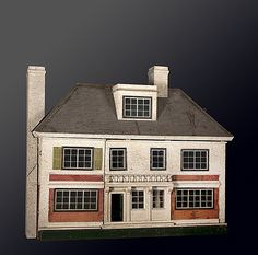 """Furnished German Doll House, large 8 room colonial with mansard roof and detachable chimneys, fully furnished with a 2 door back which is hinged to open, probably German, early 20th century. 4' wide x 19"""" deep x 41 1/2"""" tall including the chimney. Some wear and losses."""