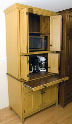 """A prim cupboard to """"hide"""" kitchen appliances!!!  Awesome! help with our lack of counter space! Definitely a different color though!"""