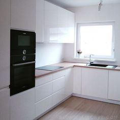 White kitchen with wooden countertop and black household appliances .- Biała kuchnia z drewnianym blatem i czarnymi sprzętami A… in 2020 Kitchen Room Design, Luxury Kitchen Design, Kitchen Dinning, Living Room Kitchen, Home Decor Kitchen, Interior Design Kitchen, Home Kitchens, Kitchen Small, Diy Kitchen Remodel