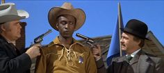 Blazing Saddles-Sheriff Bart gets a not-so-warm welcome from the citizens of Rockridge.