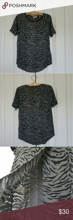 """▪Rebecca Taylor Gray/Black Tiger Print Burnout Top Brand new with tags. The last picture shows a stain on the back. Short sleeves in black with gray. The back is cross over as seen on the picture. Shell fabric 60% cotton, 40% polyester and combo is 100% silk. Measures 18"""" across the bust without stretching. Kind of sheer around the black.  No trades. If you have any questions please ask. If you don't like the price please use the offer button.  Have an amazing day! """"Great Sense of Style""""…"""