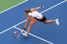 Petra Kvitova of Czech Republic stretches to reach the ball during her women's singles first round match against Polona Hercog of Slovenia on Day One of the 2012 US Open