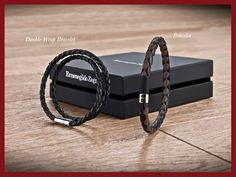 Ermenegildo Zegna - Holiday Season Selection - Black or brown leather braided bracelet with silver round clap? Discover the perfect gift for you.