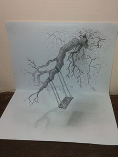 Very evidently this is a perspective drawing of a swing suspended from a tree.  The tree in itself is made to look like its grown into the plane of the paper , thereby leaving the paper nearly shattered.  Only standard shading pencils were used for this drawing.  It took a little less than 2 hours to complete this.