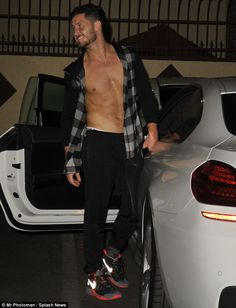 How did that happen?: The dancer just so happened to leave his black and grey plaid shirt unbuttoned