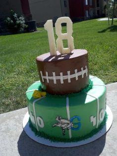 18th Birthday Football Cake - 18th Birthday cake, Strawberry-lemonade cake with lemon custard and fresh strawberries.  The logo is the High School team the birthday boy plays for.