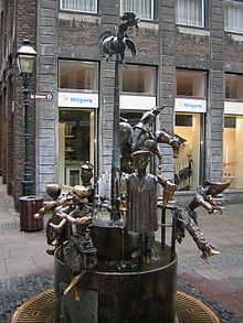 Aachen, fountain with puppets. You can move the puppets and create your own fountain - until the next pair of hands that change it again.