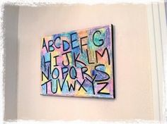 Crayon Canvas Alphabet Art!  Fun Easy Toddler or Preschool artwork you can make together! All you need is a blank canvas, crayons and a permanent black marker.