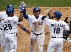 Grand slam! Rangers congratulate Carlos Gomez on his fourth-inning grand slam Wednesday, August 31, 2016. (Tom Fox/The Dallas Morning News)
