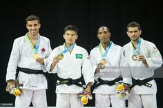 July 12 - Judo - Men's - 66 kg. Gold medalist Marti Malloy (2nd Left) is joined by silver medalist Antoine Bouchard of Canada (L), and bronze medalists Fernando Gonzales of Argentina (R) and Carlos Tondique of Cuba during the medal ceremony for the men's judo 66kg class at the 2015 Pan American Games in Toronto, Canada, July 12, 2015 AFP PHOTO/GEOFF ROBINS