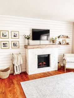 See how we built a brick DIY Fireplace around an electric insert AND stayd within budget! A step-by-step guide of what we did and learned along the way. Wood Mantle Fireplace, Build A Fireplace, Farmhouse Fireplace, Fireplace Inserts, Fireplace Mantle, Fireplace Surrounds, Fireplace Modern, Fireplace Decorations, Fireplace Ideas