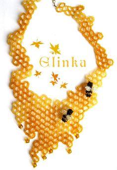 Amazing bead weaving technics used to make this honeycomb bee necklace. By Elina Ivanova