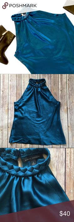 Banana Republic 100% Silk Top Braided Neck This is a gorgeous 100% silk top from Banana Republic. Braided neckline buttons behind the neck. Keyhole back. My camera could not capture the true beauty of the color of this top - in person it's more of a shiny blue/green (close up photo is the closest to the actual color). Excellent pre-loved condition, no signs of wear whatsoever.   no trades no modeling ✅dog friendly/smoke free home ✅reasonable offers ✅bundle & save! Banana Republic Tops…