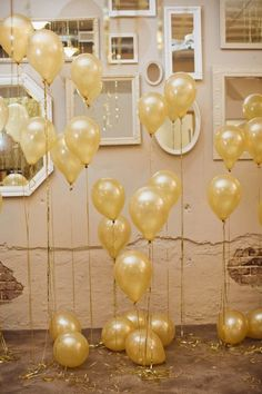 A wall of gold balloons.