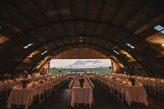 Rachel and Simon's Chic Air Hangar Wedding Photo by Todd Hunter McGaw http://www.toddhuntermcgaw.com.au/