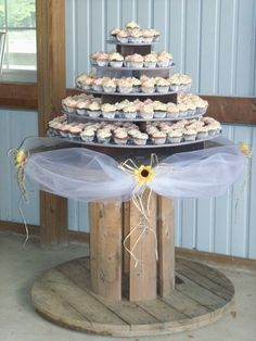 Large round Cupcaketree cupcake stand wedding photos by courtney