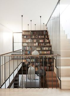 The entire back wall of the stairwell has been in-built with a towering bookshelf. More books can be stored in the stepped shelving unit that's been built to sit alongside the steps. Luigi, Glass Conservatory, Sydney, Journal Du Design, Storey Homes, Wooden Dining Tables, Color Tile, Metal Roof, Bay Window