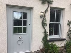 Painswick door and uPVC Sash Window, on this beautiful