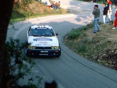 """legendsofracing: """" Yves Loubet and Jean-Marc Andrié, in their Rothmans Alfa Romeo Alfetta GTV6, passing by some spectators during the Tour de Corse-rally, 1986. """""""