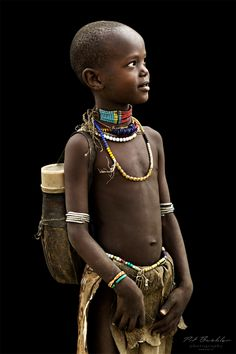 "Africa | Young Girl from the Arbore Tribe. Omo Valley, Ethiopia | ©Pit Buehler from a series called ""African Vogue"" October 2013."