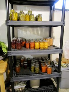 Home canned food stored on metal shelves {featured on Home Storage Solutions 101}