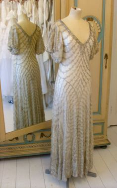 1930s warm silver lame A sophisticated and unusual Winter wedding dress. Silver and gold lame were frequently used in top end evening and bridal wear, this dress is made from delicate cream lace shot through with scallops of warm silver lame. http://www.abigailsvintagebridal.co.uk